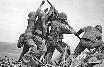 Ira Hayes and his fellow Marines raise the American flag on Feb. 23, 1945, at Mt. Suribachi, showing that the Americans had defeated the Japanese during the Battle of Iwo Jima. The famous photo was taken  by Joe  Rosenthal.