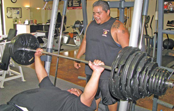 Toqua-Hanai Ticheahkie heaves 505 lbs. into the air while Martin Flores encourages him. NATIVE TIMES PHOTO BY DANA ATTOCKNIE