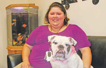 Rachel Howard, alcohol and drug counselor for the Cherokee Nation Jack Brown Center, and her dog, Lulu, work together in helping youth overcome addiction. PHOTO COURTESY CHEROKEE NATION COMMUNICATIONS OFFICE