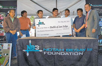 San Felipe Pueblo leaders take part in a May 6 groundbreaking ceremony for a youth soccer field with NB3 founder Notah Begay, far right. The collegiate-size field was recently completed and will serve the pueblo's youth soccer club. Photo courtesy of the NB3 Foundation.