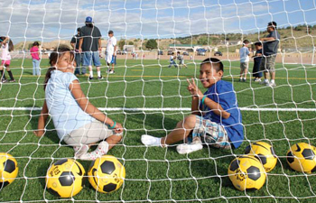 Children from the San Felipe Soccer Club enjoy a brand-new field Aug. 23. Photo COURTESY NB3 FOUNDATION